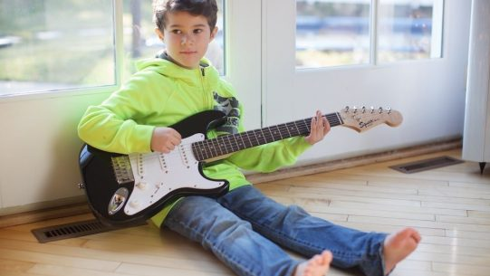 Young child holding guitar - 2178-min